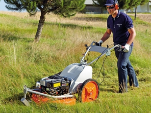 Lawn mowers with side discharge