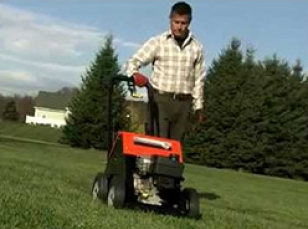 Vertical turf aerators